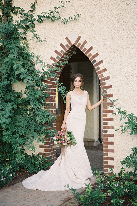 Kestrel-Park-venue-bride-alone-bride-in-a-fitted-gown-with-straps-and-lace-design