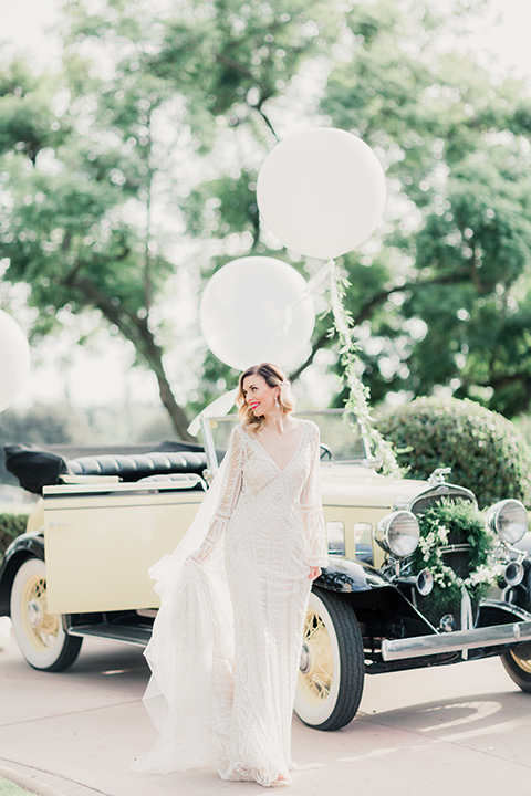 MUCKENTHALER-SHOOT-bride-and-groom-with-balloons-bride-in-fitted-satin-long-sleeve-gown