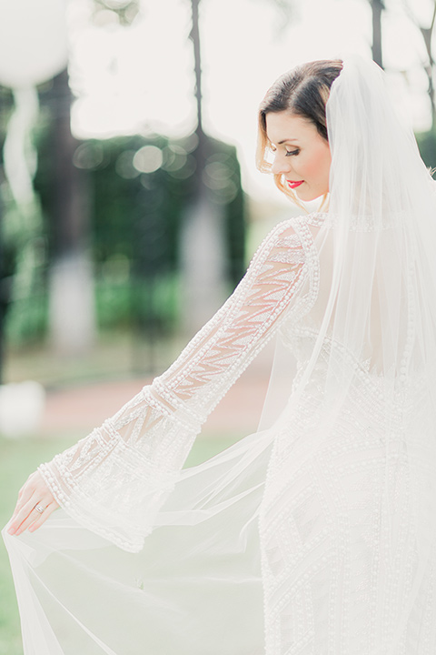 MUCKENTHALER-SHOOT-bride-twirling-bride-in-fitted-satin-long-sleeve-gown