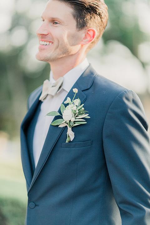 MUCKENTHALER-SHOOT-groom-smiling-turned-sideways