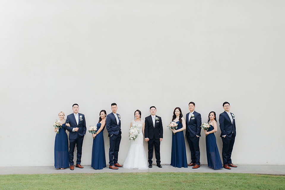 occidental-college-wedding-bridal-party-groom-in-black-tuxedo-bride-in-a-fitted-gown-with-a-beaded-bodice-bridesmaids-in-blue-gowns