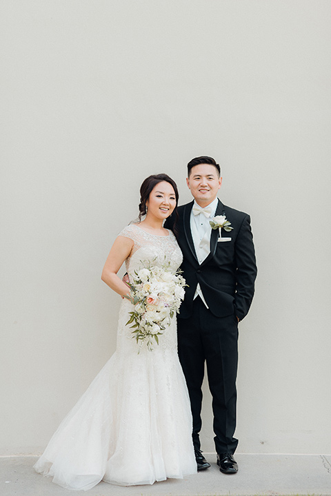 occidental-college-wedding-bride-and-groom-standing-groom-in-black-tuxedo-bride-in-a-fitted-gown-with-a-beaded-bodice
