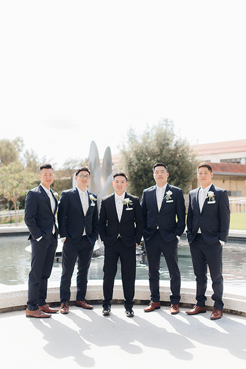 occidental-college-wedding-groomsmen-by-fountain