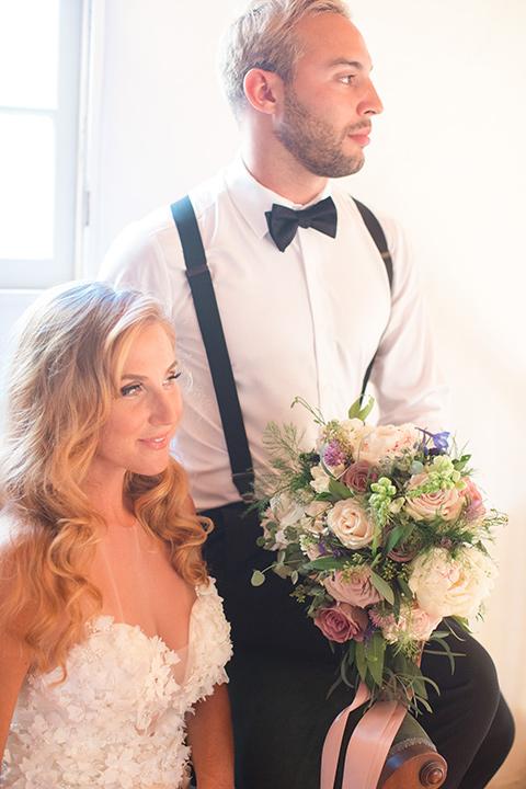 rockwood-shoot-bride-and-groom-in-chair-looking-away-groom-with-no-jacket