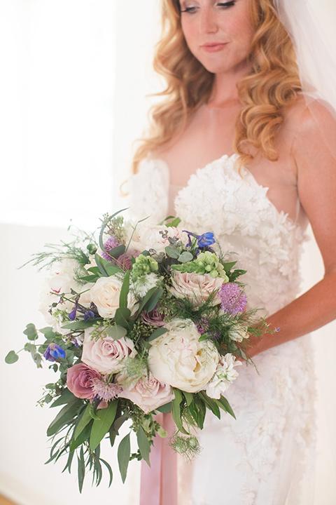 rockwood-shoot-bride-holding-flowers-rockwood-shoot-bride-full-length-in-dress-looing-down