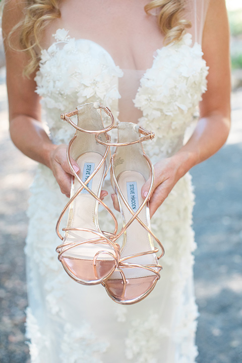 rockwood-shoot-bride-holding-shoes-bride-in-a-ball-gown-holding-gold-heels