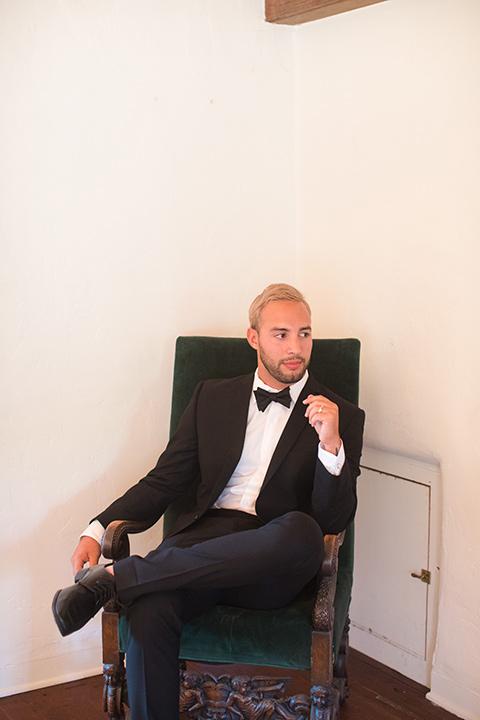 rockwood-shoot-groom-sitting-in-chair-looking-away