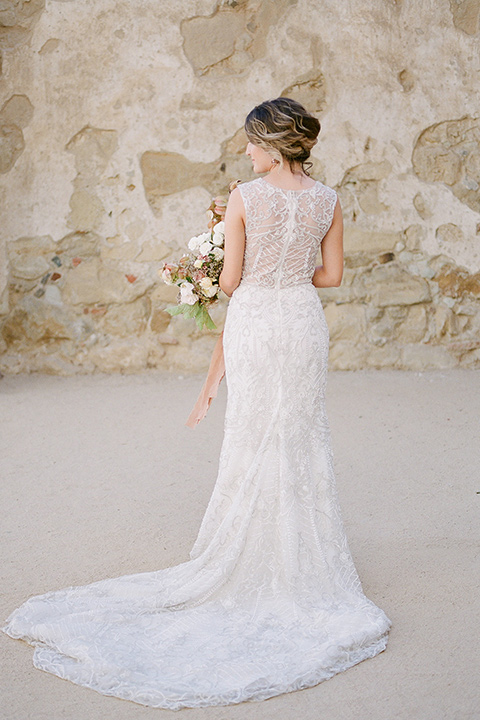 san-juan-capastrano-wedding-bride-ack-turned-bride-in-a-white-fitted-silk-dress-with-cap-sleeves-and-an-illusion-neckline-and-back