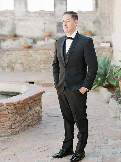 san-juan-capastrano-wedding-groom-standing-groom-in-a-black-tuxedo-with-black-bow-tie