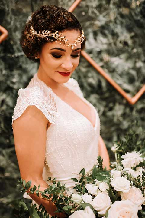 santa-anita-park-art-deco-shoot-bride-with-headpiece-on-bride-wearing-a-vintage-inspired-dress-with-delicate-beading-and-flutter-sleeves-groom-wearing-a-white-tuxedo-jacket-with-black-trim-and-black-pants