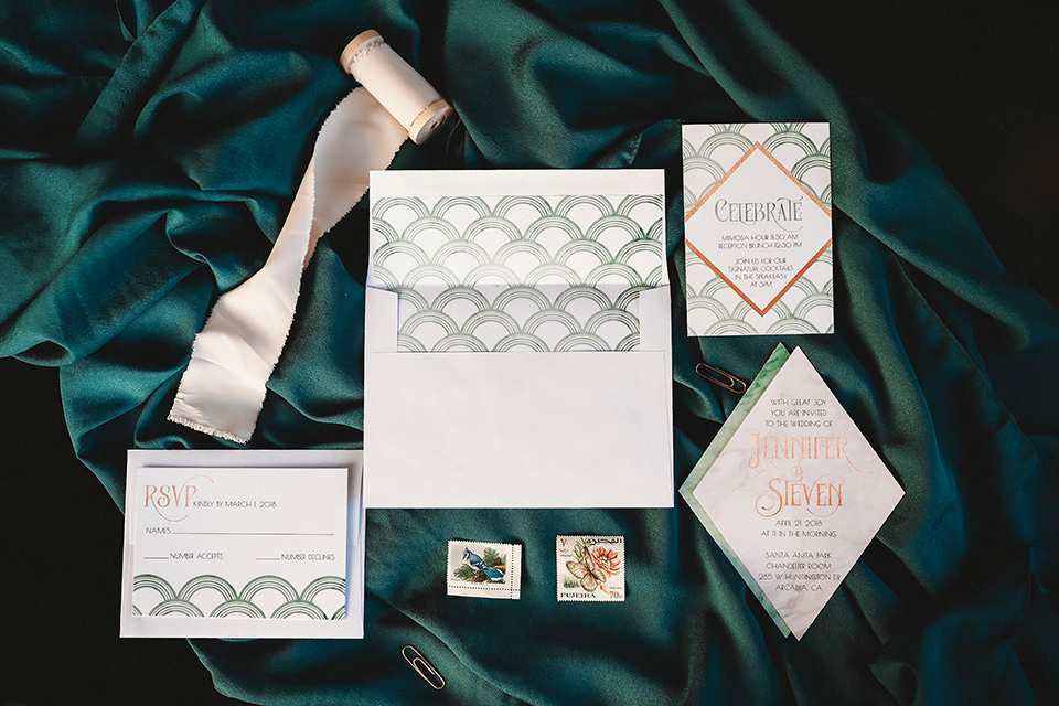 santa-anita-park-art-deco-shoot-invitations-white-paper-with-soft-writing-and-a-deep-teal-linen
