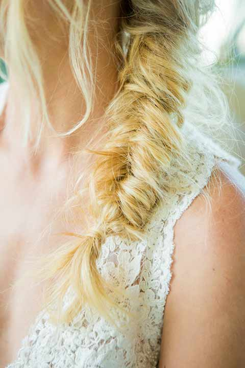 seapoint-bridal-shoot-bridal-braid-bride-in-a-lace-gown-with-thick-lace-straps-and-hair-in-a-loose-braid