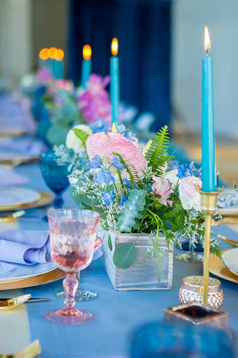 seapoint-bridal-shoot-candles-and-table-décor-bright-blue-inens-with-blue-candles-and-pink-accents