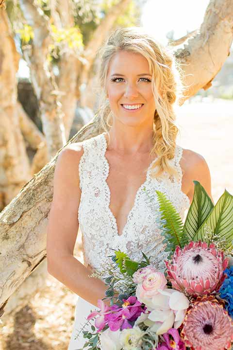 seapoint-bridal-shoot-close-up-on-bride-bride-in-a-lace-gown-with-thick-lace-straps-and-hair-in-a-loose-braid