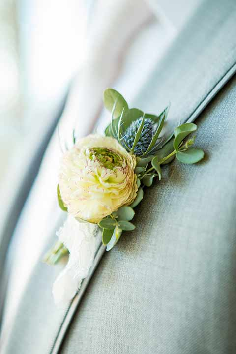seapoint-bridal-shoot-groom-floral-groom-in-a-light-grey-suit-with-a-white-long-tie