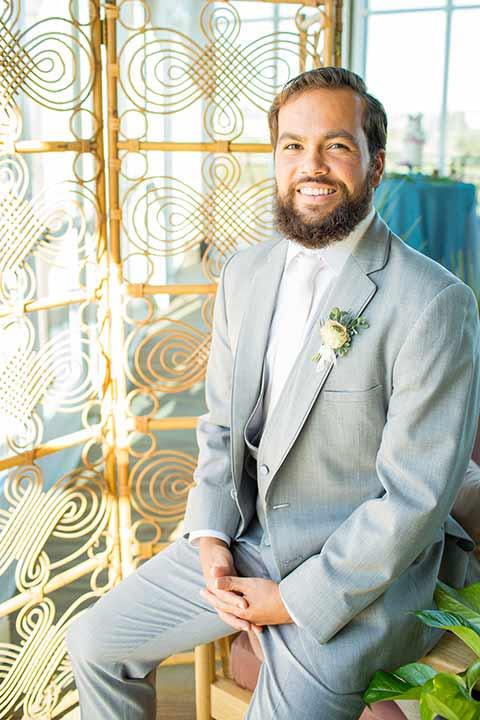 seapoint-bridal-shoot-groom-sitting