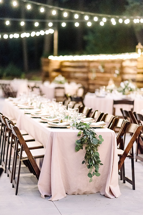 skypark-styled-shoot-string-lights-and-ceremony-space-pink-linens-and-brown-wooden-chairs