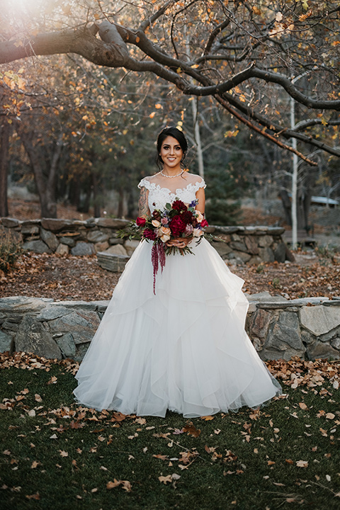 the-guest-ranch-bride-standing-bride-in-a-tulle-ball-gown-with-straps-and-a-beaded-bodice