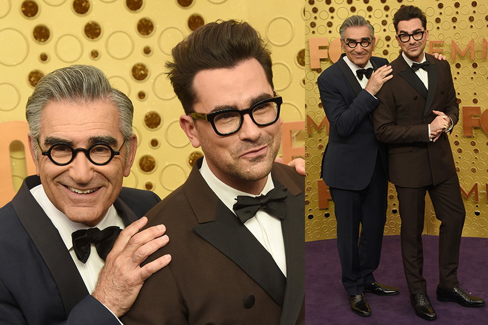 Daniel Joseph Levy and father Eugene Levy at the 2019 Emmys, wearing a brown double breasted tuxedo coat and a navy blue shawl lapel tuxedo coat