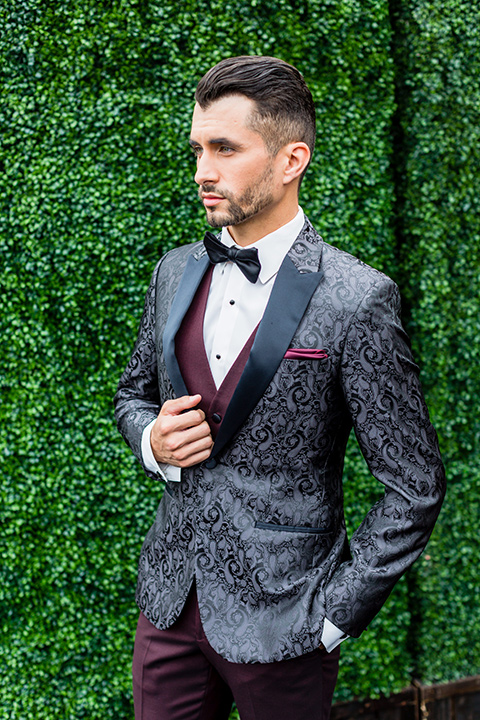 Lakewood-store-45th-anniversary-party-model-in-black-paisley-coat-with-a-burgundy-vest-and-pants