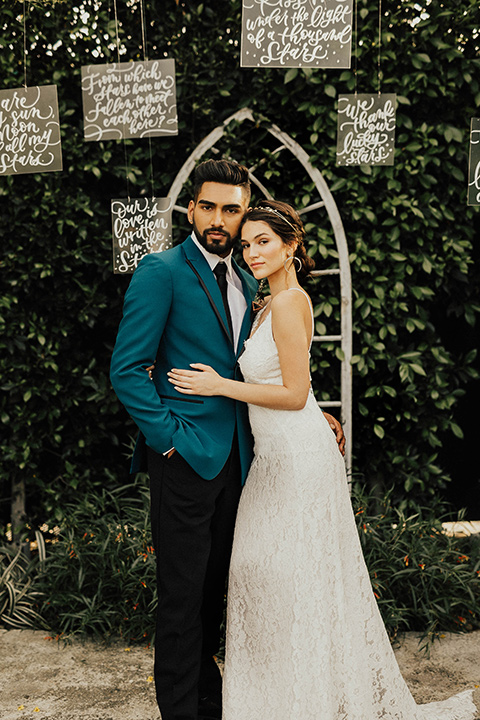 The-Ruby-Street-photoshoot-bride-and-groom-at-ceremony-groom-in-a-teal-tuxedo-jacket-with-black-pants-and-a-black-bowtie