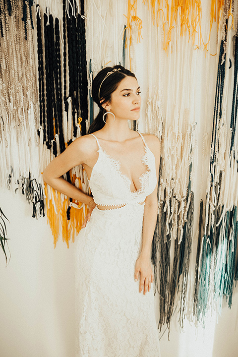The-Ruby-Street-photoshoot-bride-looking-to-the-side-bride-in-a-lace-dress-with-a-deep-v-neckline