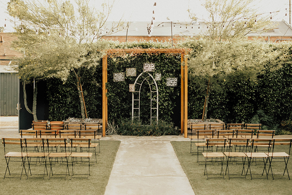 The-Ruby-Street-photoshoot-ceremony-space-with-light-wood-chairs-and-archway