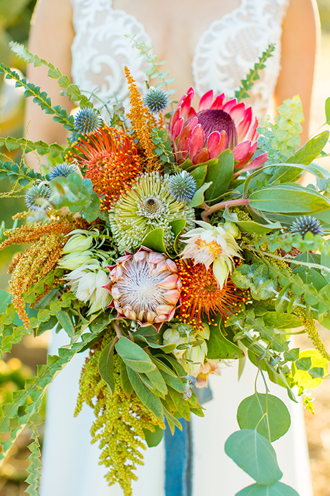 A-Stones-Throw-Winery-African-Shoot-bridal-flowers-in-bright-pinks-and-yellows-with-troical-greens
