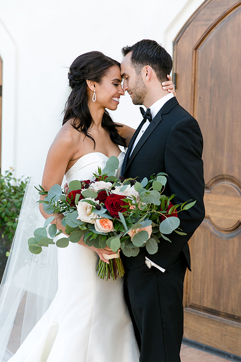 Villa-de-Amore-bride-and-groom-touching-heads-bride-and-groom-by-ivy-bride-in-a-fitted-gown-groom-in-a-black-tuxedo