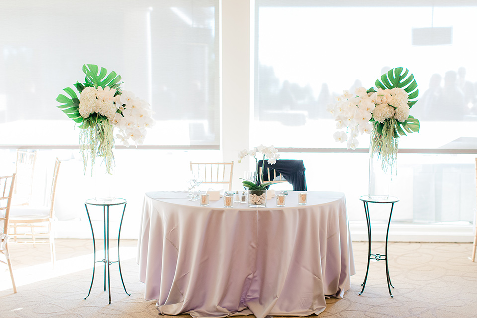 Los-Verdes-Golf-Course-Wedding-sweetheart-table-with-blush-pink-table-linens-and-white-and-gold-decor