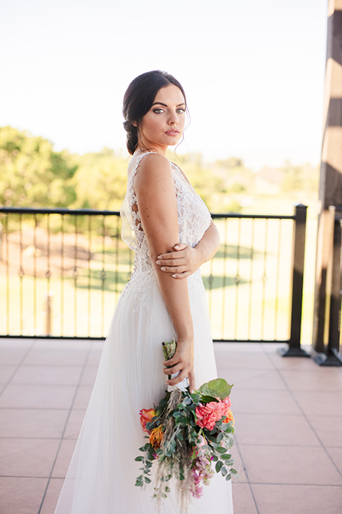 aliso Viejo wedding design with the bride in a lace gown with thin straps