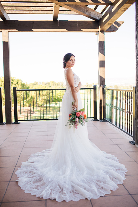 aliso viejo wedding design with the bride in a lace white gown with thin straps and a full skirt