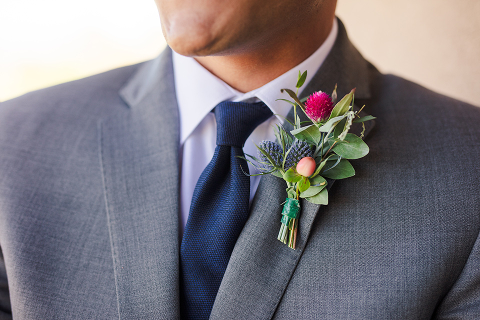 Aliso Viejo wedding design the groom in a grey suit with a blue neck tie