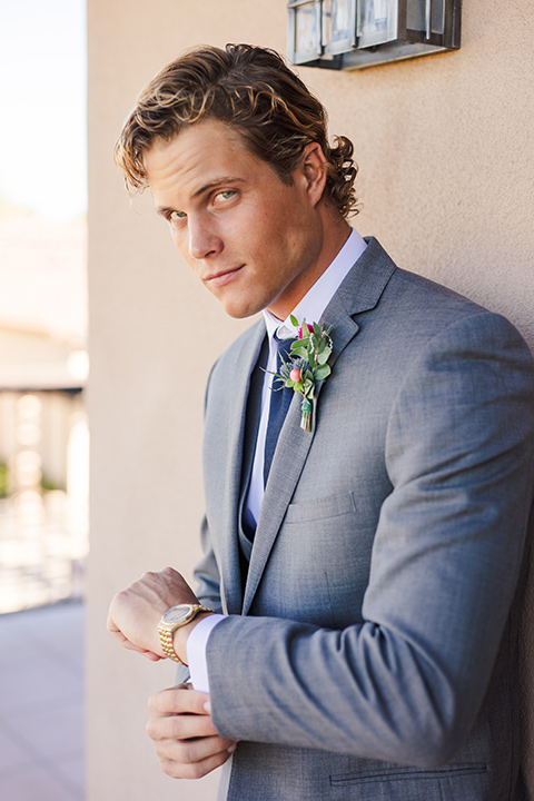 aliso Viejo wedding design with the groom in a grey suit with a navy neck tie