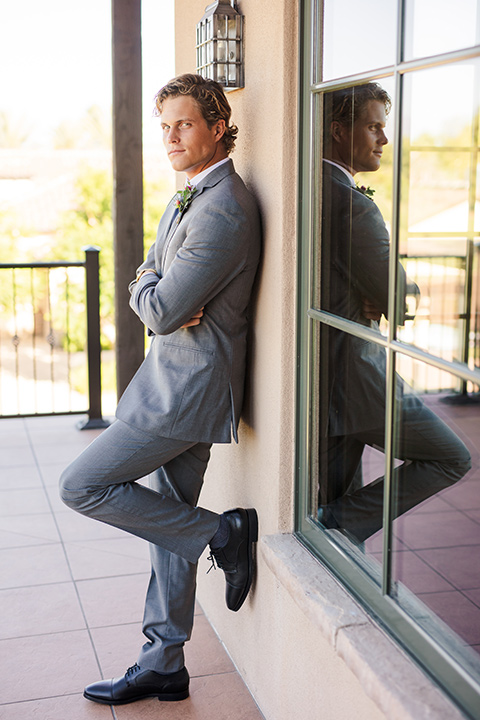 aliso viejo wedding design with the groom in a grey suit and navy neck tie