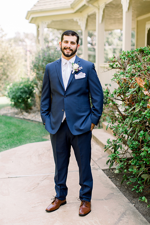 Burgundy-and-Blue-wedding-groom-standing