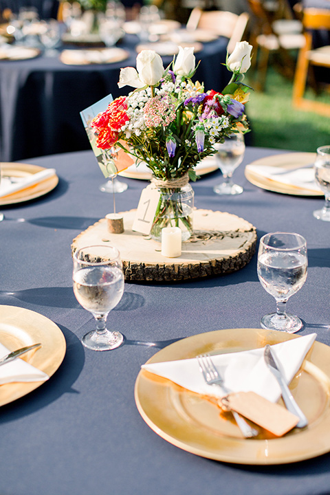 Burgundy-and-Blue-wedding-table-décor-with-dusty-blue-linens-and-white-and-gold-flatware