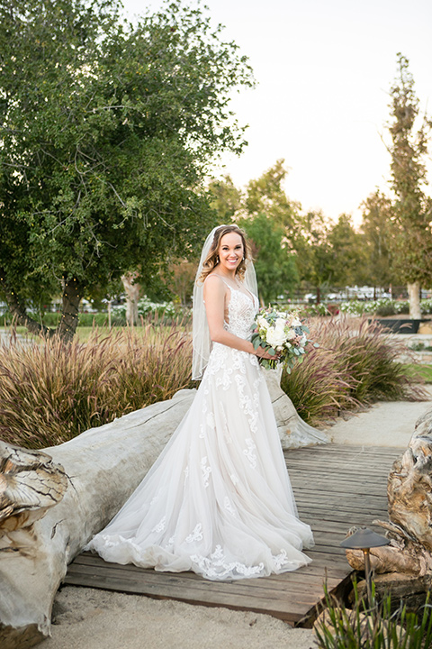 Garden-Wedding-bride-in-a-strapless-ballgown-with-her-hair-down-in-a-loose-wave