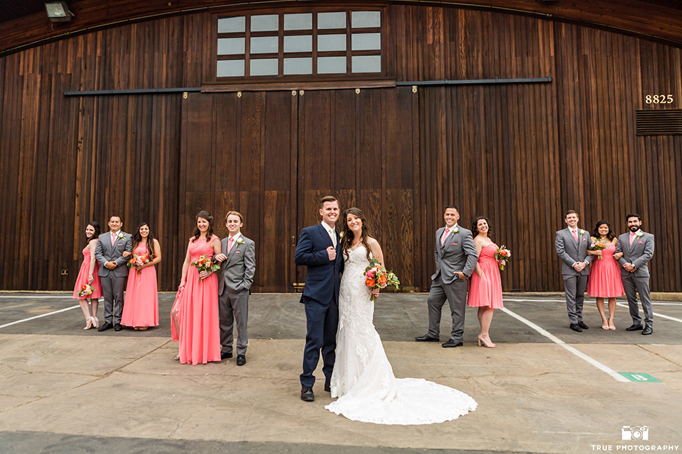 Entire bridal in front of wooden venue