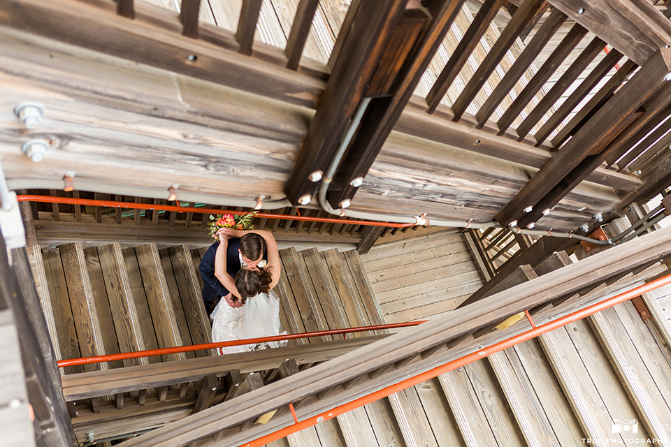 birds eye view of bride and groom kissing on stairs