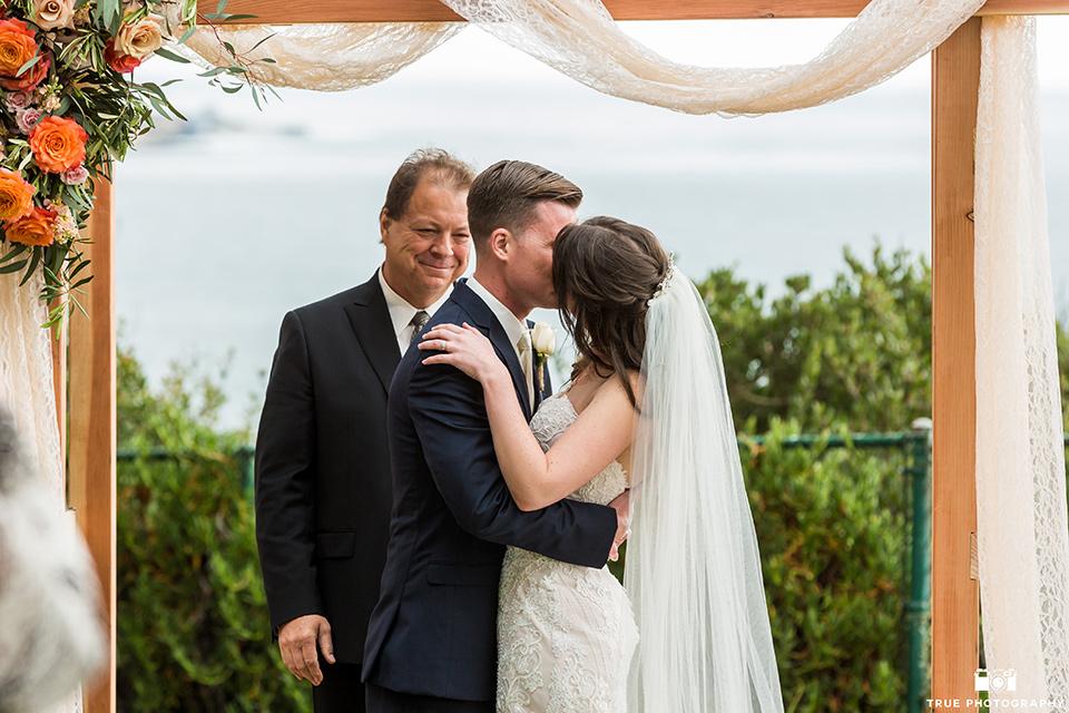 First kiss at wedding in La Jolla