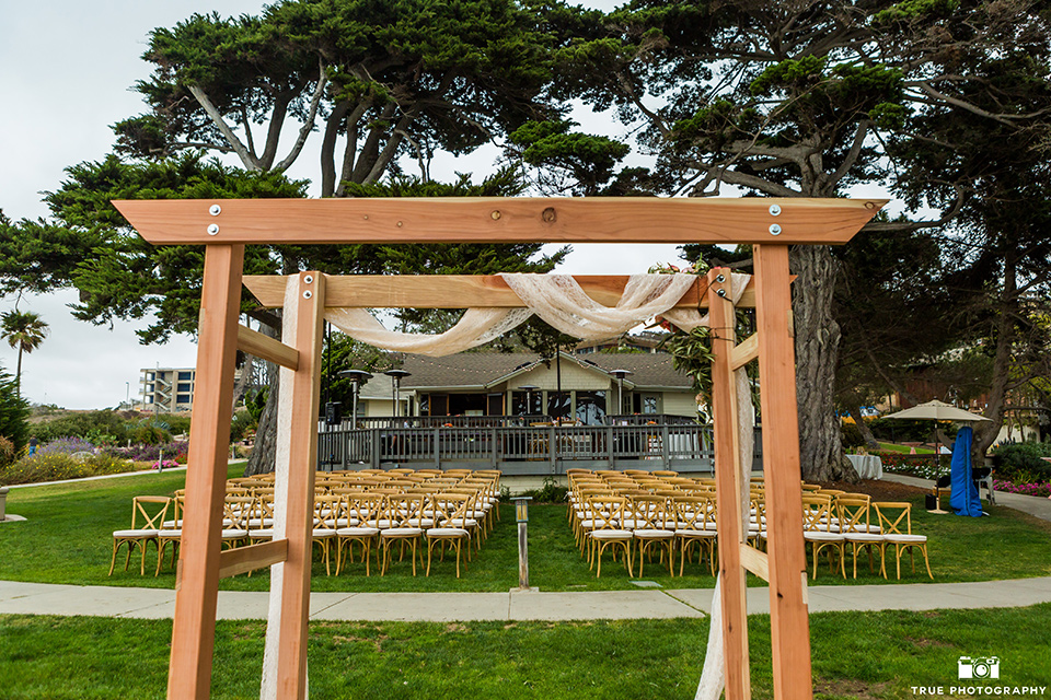 Martin Johnson House wedding ceremony with an wooden arch