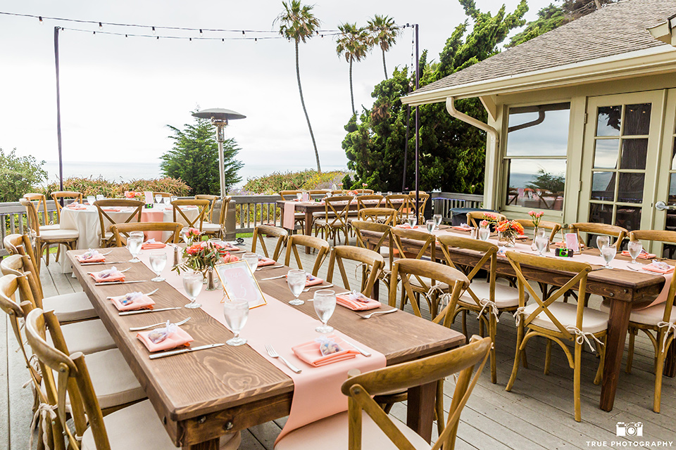 Martin Johnson House wedding reception space with wooden picnic tables and coral details