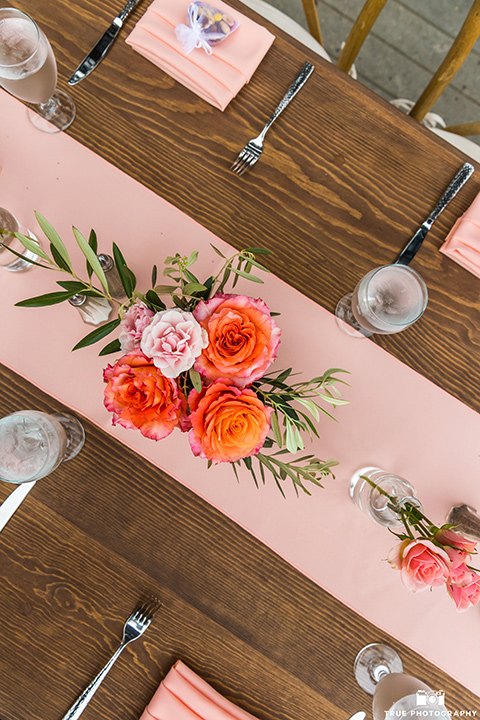 Martin Johnson House wedding table decor with light pink and floral linens pink florals and gold flatware