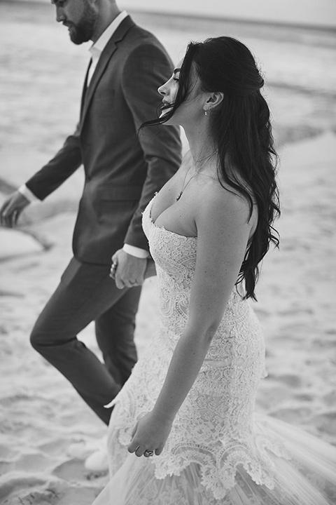Grand-Firesta-Americana-Coral-Beach-bride-and-groom-walking-on-the-beach