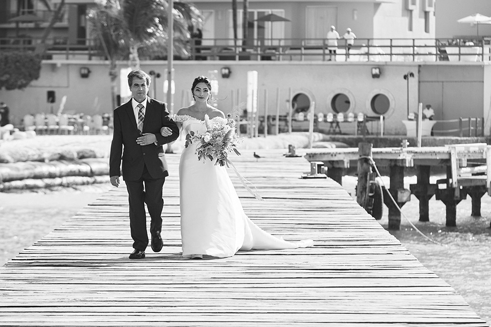 Grand-Firesta-Americana-Coral-Beach-bride-coming-down-aisle