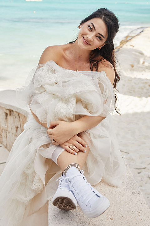 Grand-Firesta-Americana-Coral-Beach-bride-with-her-high-top-shoes