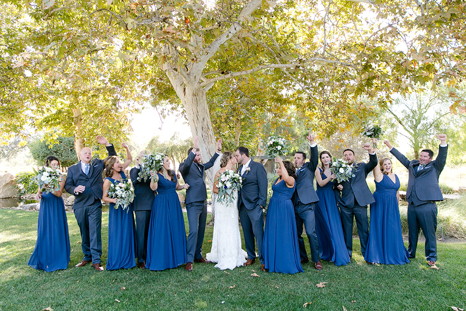 gallaway-downs-wedding-bridalparty-walking-bridesmaids-in-royal-blue-gowns-groomsmen-in-navy-blue-suits-bride-in-a-lace-a-line-gown-and-groom-in-a-navy-blue-suit-with-a-white-long-tie