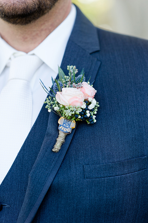 gallaway-downs-wedding-close-up-on-groom-attire-in-a-dark-blue-suit-with-a-white-long-tie