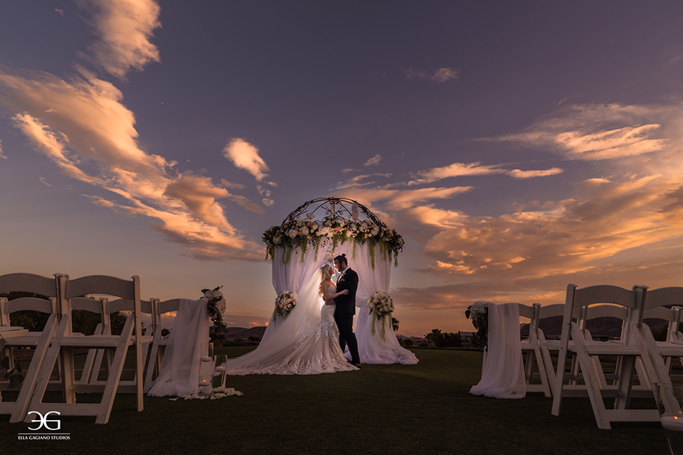 Bears-Best-Venue-Wedding-Shoot-bride-and-groom-at-ceremony-space-with-the-bride-wearing-a-long-lace-strapless-gown-and-the-groom-wearing-a-black-tuxedo-and-black-accessories